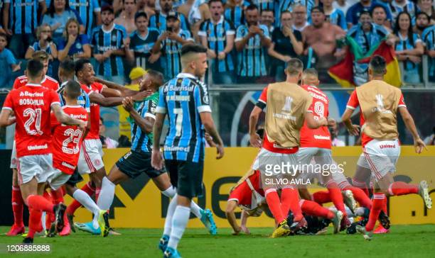 Brazil's Internacional and Brazil's Gremio players take part in a brawl during their 2020 Copa Libertadores match at the Arena do Grêmio in Porto...