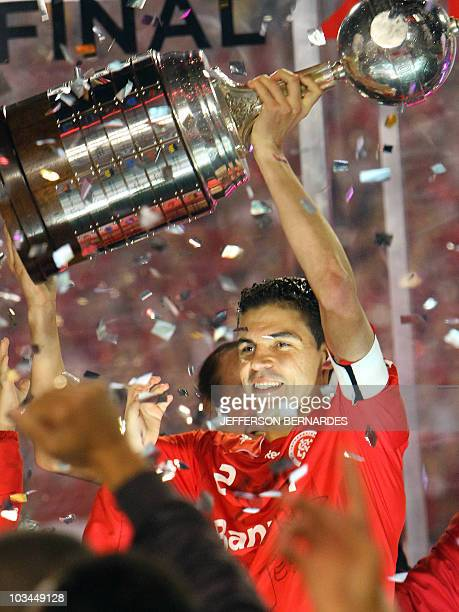 Brazil's Internacional footballer Bolivar holds the Libertadores Cup after the final match with Chivas of Mexico at the Beira Rio Stadium in Porto...