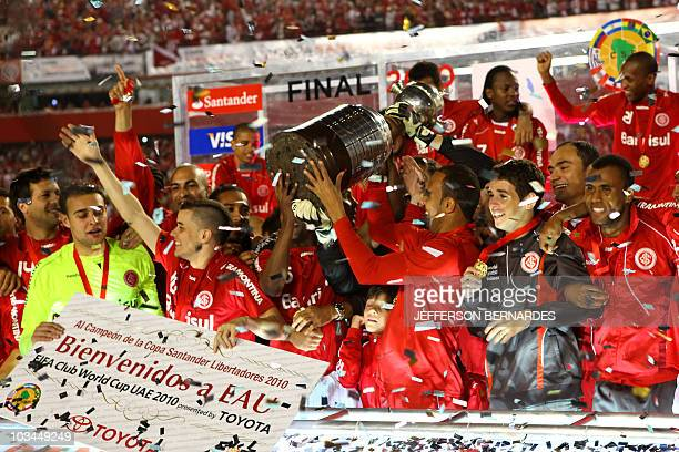 Brazil's Internacional footballers celebrate winning the Libertadores Cup after the final match with Chivas of Mexico at the Beira Rio Stadium in...