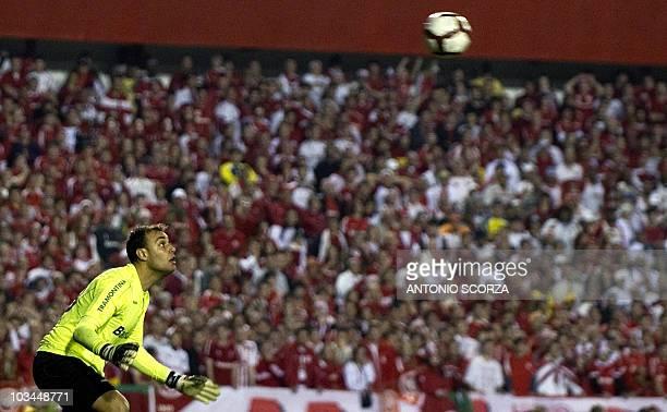 Brazil's Internacional goalkeeper Renan eyes the ball kicked by Mexico's Chivas footballer Marco de la Mora during their Libertadores Cup final on...