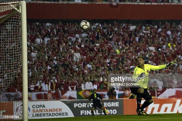 Brazil's Internacional goalkeeper Renan fails to stop the ball kicked by Mexico's Chivas footballer Marco de la Mora during their Libertadores Cup...