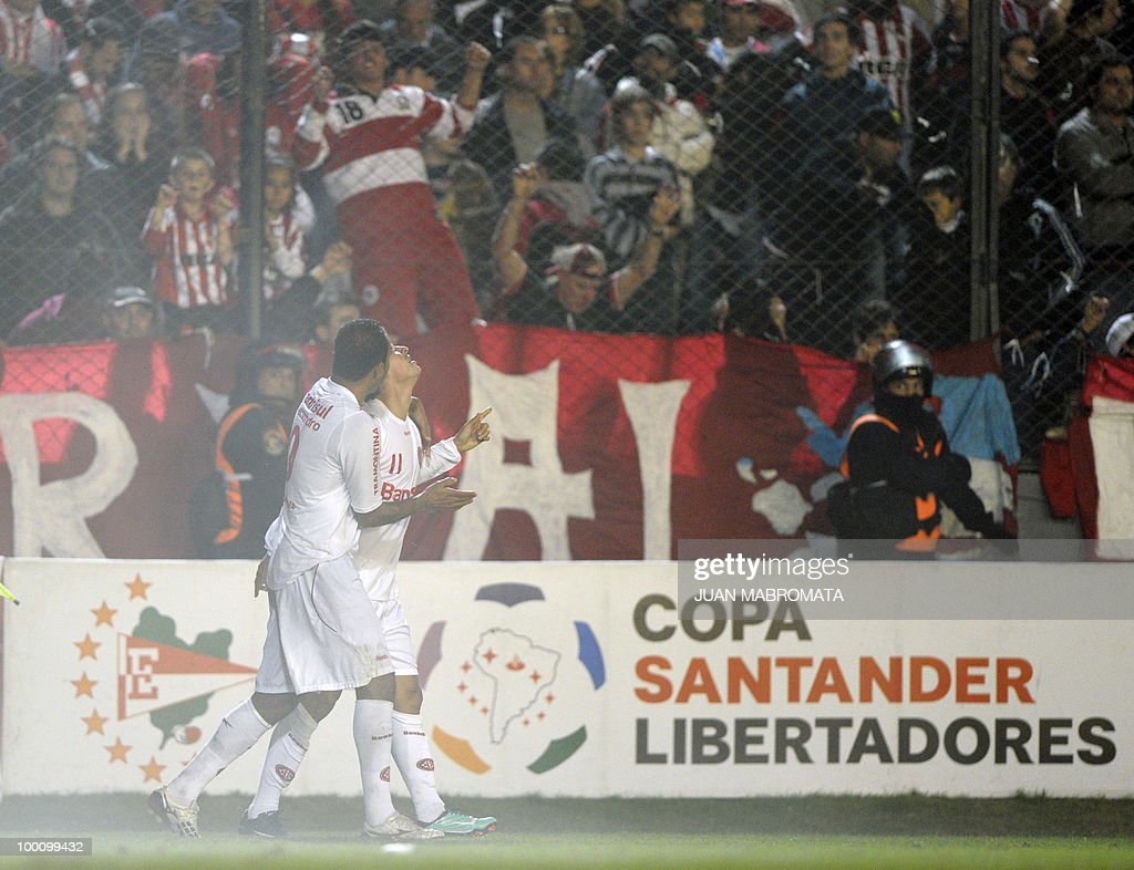 Brazil's Internacional midfielder Giuliano (R) celebrates with teammate forward Alecsandro after scoring against Argentina's Estudiantes during the second leg of the Copa Libertadores 2010 quarterfinals football match at Centenario stadium in Quilmes, south Buenos Aires, on May 20, 2010. Estudiantes won 2-1 but Internacional qualifying for next round on aggregate goals. AFP PHOTO / Juan Mabromata