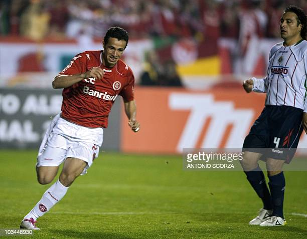 Brazil's Internacional player Leandro Damiao celebrates his goal against Mexico's Chivas on August 18 2010 during their Libertadores final football...