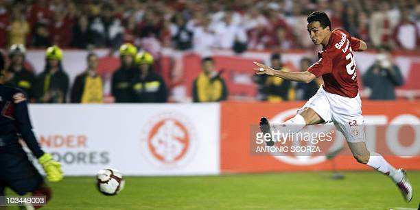 Brazil's Internacional player Leandro Damiao kicks to score against Mexico's Chivas on August 18 2010 during their Libertadores final football match...