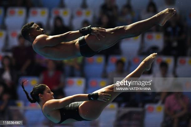 Brazil's Isaac Filho and Brazil's Ingrid Oliveira compete in the mixed synchronised 10m platform diving final during the 2019 World Championships at...