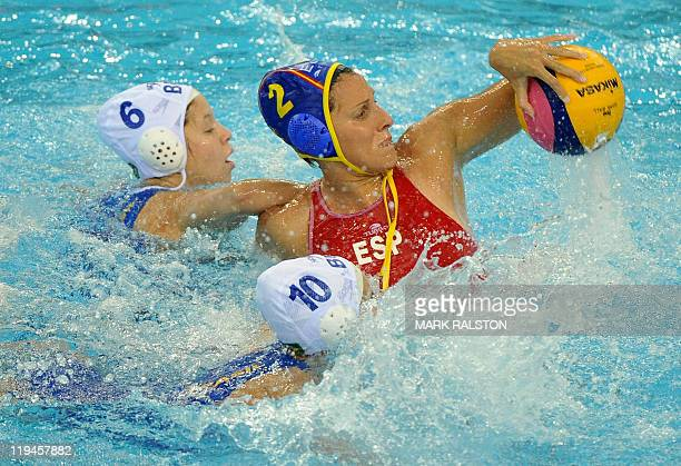 Brazil's Izabella Chiappini and Brazil's Gabriela Gozani fight for the ball with Spain's Blanca Gil Sorli during their women's group C water polo...