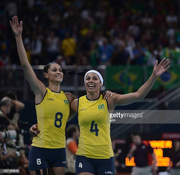 Brazil's Jaqueline Carvalho and Paula Pequeno celebrate after winning the gold medal by defeating the US in the women's volleyball gold medal match...