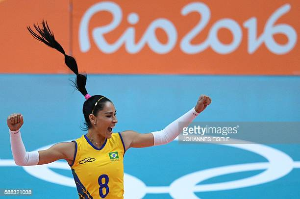 TOPSHOT Brazil's Jaqueline Endres celebrates after winning a point during the women's qualifying volleyball match between Brazil and Japan at the...