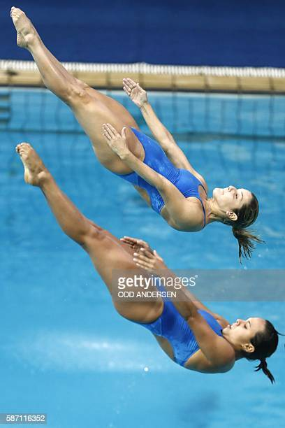 Brazil's Juliana Veloso and Brazil's Tammy Takagi compete in the Women's Synchronized 3m Springboard Final during the diving event at the Rio 2016...