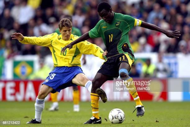 Brazil's Juninho and Jamaica's Theodore Whitmore battle for the ball
