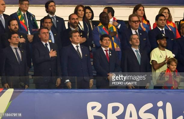 Brazil's Justice Minister Sergio Moro Brazilian President Jair Bolsonaro the president of the South American football's governing body Conmebol...
