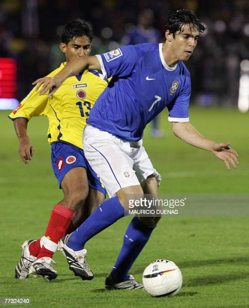 Brazil's Kaka dribbles past Colombia's Jose Amaya 14 October in Bogota during their South American qualifiers for the FIFA World Cup South Africa2010...