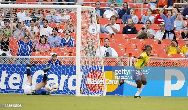 Brazil's Katia celebrates after scoring her team's fourth goal against Norway's goalie Bente Nordby during their Group B soccer match in the 2003...
