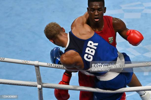 Brazil's Keno Machado and Britain's Benjamin Whittaker fight during their men's light heavy quarter-final boxing match during the Tokyo 2020 Olympic...