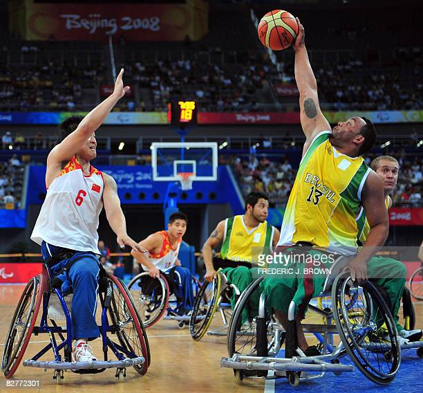 Brazil's Leandro Mirando blocks a pass by China's Yang Lei in their men's wheelchair basketball game at the 2008 Beijing Paralympic Games on...
