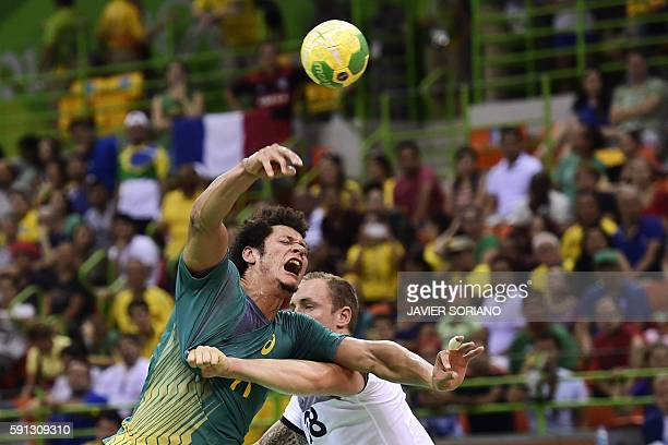 TOPSHOT Brazil's left wing Thiagus dos Santos vies with France's right wing Valentin Porte during the men's quarterfinal handball match Brazil vs...