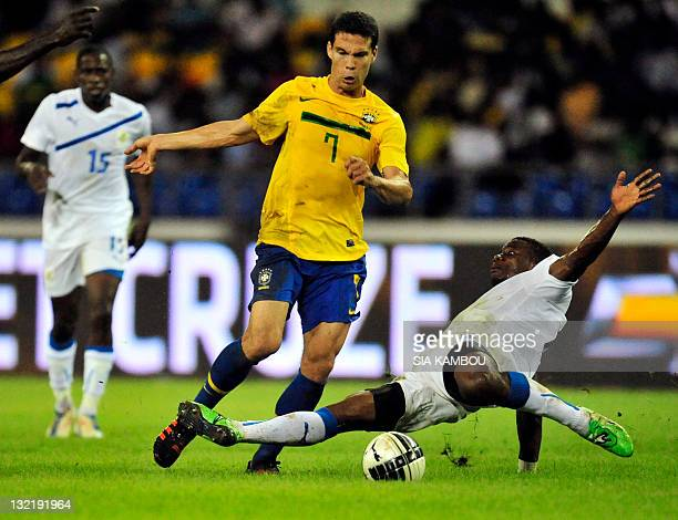Brazil's Lima Anderson fights for the ball with Gabon's Andre Biyogho Poko during their friendly football match Gabon vs Brazil at the Stade de...