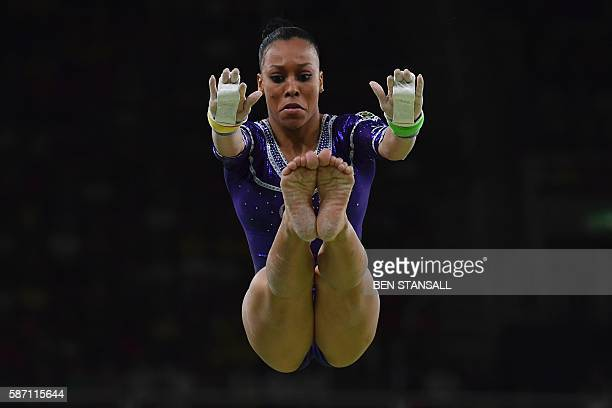 Brazil's Lorrane Oliveira competes in the qualifying for the women's Uneven Bars event of the Artistic Gymnastics at the Olympic Arena during the Rio...