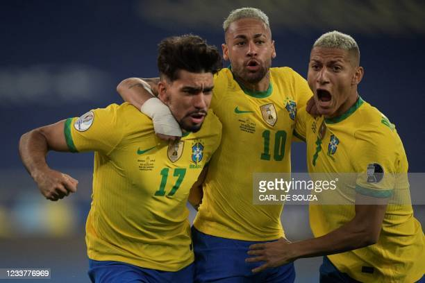Brazil's Lucas Paqueta celebrates with Brazil's Neymar and Brazil's Richarlison after scoring against Chile during their Conmebol 2021 Copa America...