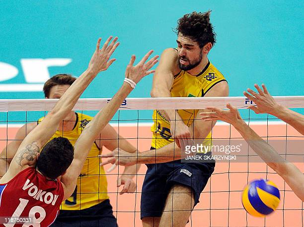 Brazil's Lucas Saatkamp spikes the ball against Russia's Alexander Volkov during their Volleyball World League gold medal game in Gdansk on July 10...