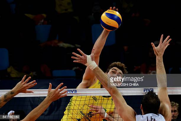 Brazil's Lucas Saatkamp spikes the ball against the USA during their FIVB Men's Volleyball World Grand Prix 2016 at Carioca Arena 1 of the Olympic...