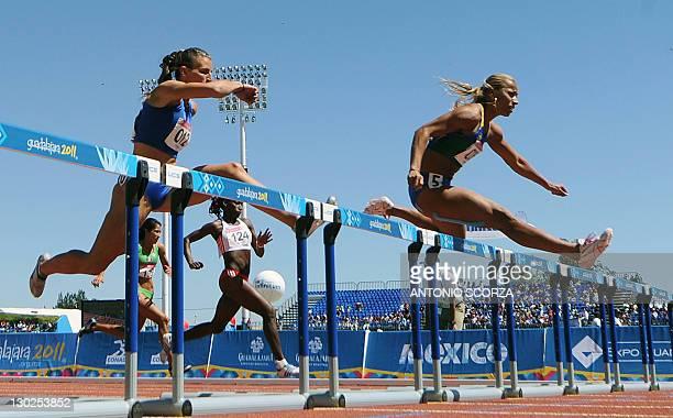 Brazil's Lucimara da Silva races to win the Women's 110m Hurdles Heptathlon heat 2 followed by Argentina's Agustina Zerboni during the XVI...