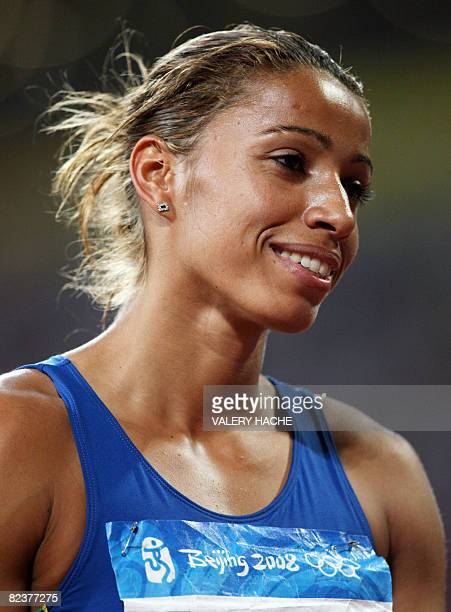 Brazil's Lucimara Silva reacts after competing in the women's heptathlon javelin throw at the Bird's Nest National Stadium as part of the 2008...