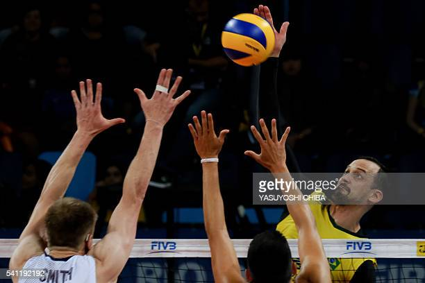 Brazil's Luis Felipe Marques Fonteles spikes the ball against the USA during their FIVB Men's Volleyball World Grand Prix 2016 at Carioca Arena 1 of...