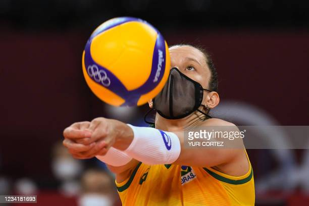 Brazil's Macris Silva Carneiro sets the ball in the women's preliminary round pool A volleyball match between Brazil and South Korea during the Tokyo...