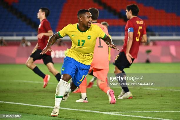 Brazil's Malcom Filipe celebrates after scoring against Spain during the Tokyo 2020 Olympic Games football competition men's gold medal match at...