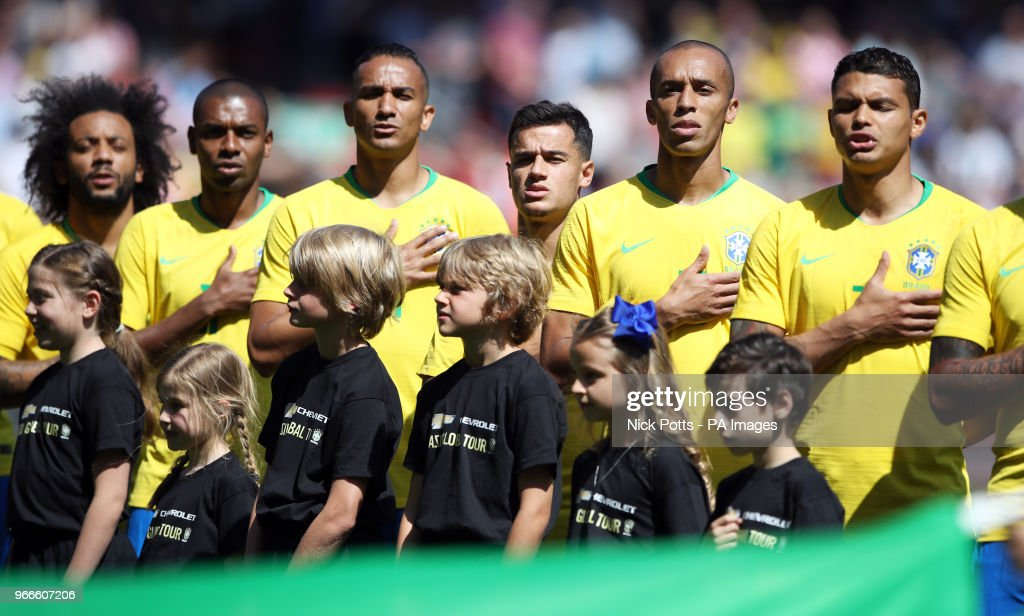 Brazil's (from left to right) Marcelo, Fernandinho, Danilo, Philippe Coutinho, Joao Miranda and Thiago Silva sing the national anthem before the International Friendly match at Anfield, Liverpool.