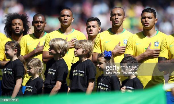 Brazil's Marcelo Fernandinho Danilo Philippe Coutinho Joao Miranda and Thiago Silva sing the national anthem before the International Friendly match...