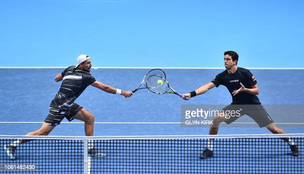 Brazil's Marcelo Melo and Poland's Lukas Kubot return against France's PierreHugues Herbert and France's Nicolas Mahut during their men's doubles...
