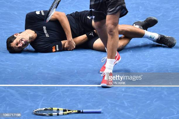 Brazil's Marcelo Melo reacts after being hit by a ball played by US player Jack Sock as Melo's partner Poland's Lukas Kubot retreives his racket...