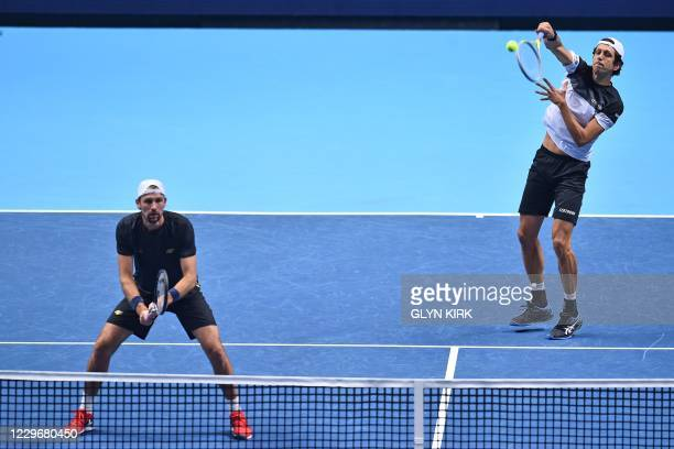 Brazil's Marcelo Melo serves while playing with Poland's Lukas Kubot against Netherlands' Wesley Koolhof and Croatia's Nikola Mektic in their men's...
