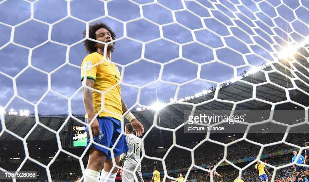 Brazil's Marcelo reacts during the FIFA World Cup 2014 semi-final soccer match between Brazil and Germany at Estadio Mineirao in Belo Horizonte,...
