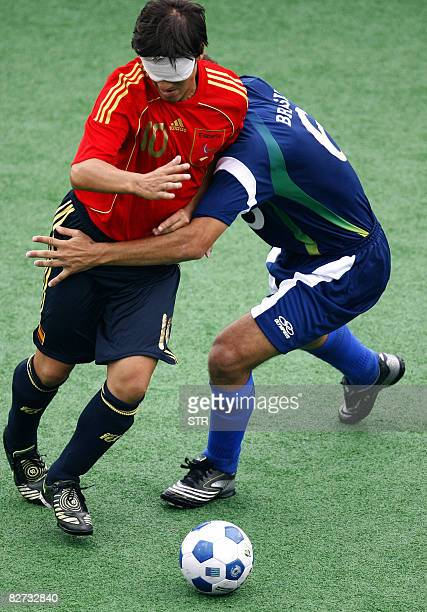 Brazil's Marcos Felipe vies with Spain's Vicente Aguilar in the men's 5aside football match during the 2008 Beijing Paralympic Games at the Olympic...