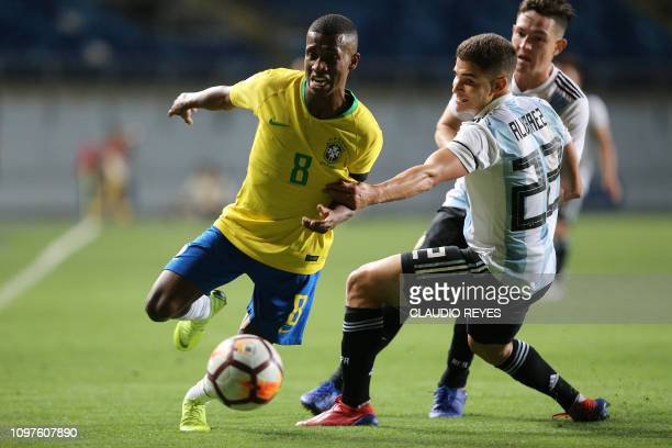 Brazil's Marcos vies for the ball with Argentina's Julian Alvarez during their South American U-20 football match at El Teniente stadium in Rancagua,...