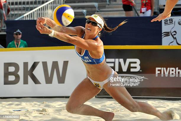 Brazils' Maria Antonelli dives for the ball during the AntonelliAgatha v XueZhang Xi game as part of the FIVB Gstaad Grand Slam fourth day on July 12...