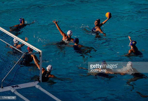 Brazil's Marina Zablith takes a shot on goal against the Hungary defence during their preliminary round match of the women's water polo competition...