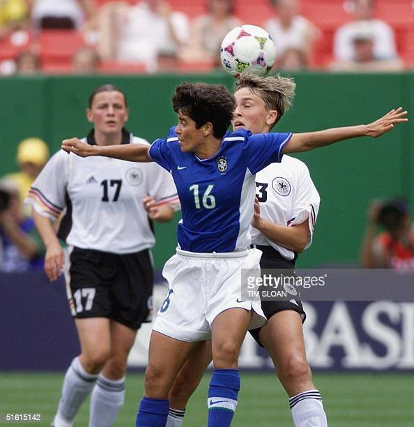 Brazil's Marisa defends against Germany's Sandra Minnert in the first half of their Women's World Cup match at Jack Kent Cooke Stadium 27 June 1999...