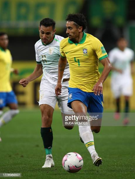 Brazil's Marquinhos and Bolivia's Bruno Miranda vie for the ball during their 2022 FIFA World Cup South American qualifier football match at the Neo...