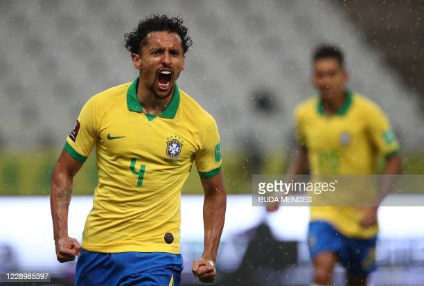 Brazil's Marquinhos celebrates after scoring against Bolivia during their 2022 FIFA World Cup South American qualifier football match at the Neo...