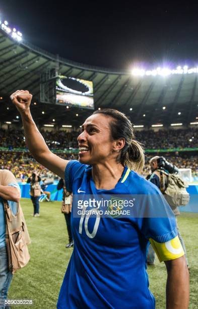 Brazil's Marta celebrates after defeating Australia in the penalty shootout of their Rio 2016 Olympic Games women's quarterfinal football match at...