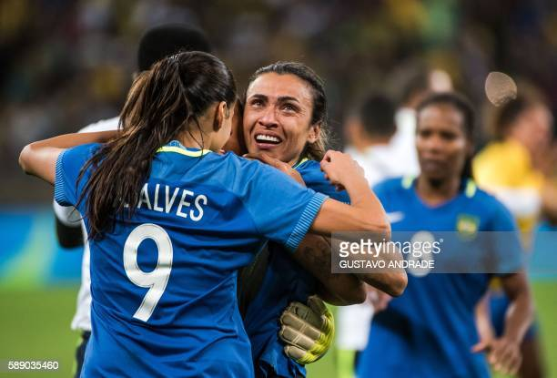 Brazil's Marta celebrates with teammates after defeating Australia in the penalty shootout of their Rio 2016 Olympic Games women's quarterfinal...