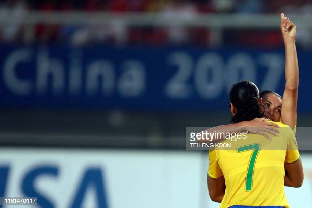 Brazil's Marta Vieira Da Silva celebrates with a teammate after scoring her first goal against New Zealand during their Group D Women's World Cup...