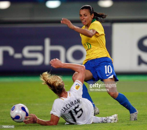 Brazil's Marta Vieira Da Silva fights for the ball with New Zealand's Maia Jackman during their Group D Women's World Cup 2007 football match in...