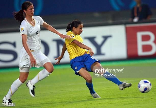 Brazil's Marta Vieira Da Silva scores her first goal as New Zealand's Abby Erceg looks on during their Group D Women's World Cup football match in...