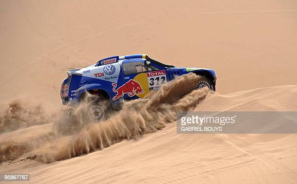 Brazil's Mauricio Jose Neves steers his Volkswagen during the 4th stage of the Dakar 2010 between Fiambala Argentina and Copiapo Chile on January 5...
