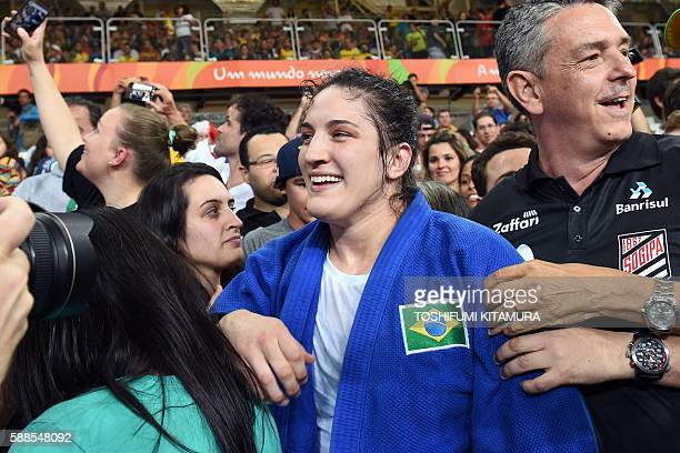 Brazil's Mayra Aguiar celebrates after defeating Cuba's Yalennis Castillo during their women's 78kg judo contest bronze medal A match of the Rio 2016...